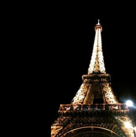 The Eiffel Tower at mid-night - Laura Spoonie