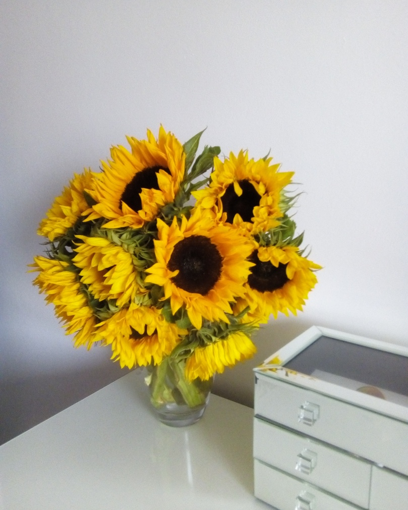 A sunflower bouquet in a vase - Laura Spoonie